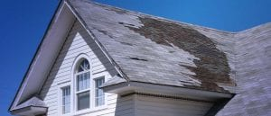Damaged Roof that Needs to Be Replaced